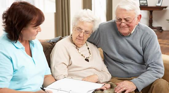 A caregiver with an older couple